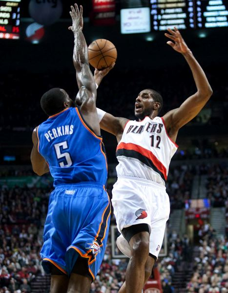 by: TRIBUNE PHOTO: CHRISTOPHER ONSTOTT - LaMarcus Aldridge of the Trail Blazers puts up a shot against Oklahoma City's Kendrick Perkins in Portland's loss at home Sunday night.