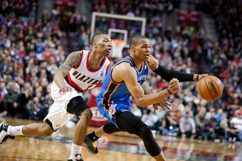 by: TRIBUNE PHOTO: CHRISTOPHER ONSTOTT - Oklahoma City's Russell Westbrook drives around Portland's Damian Lillard.