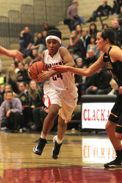by: PHOTOJONATHAN HOUSE - With determination, Clackamas senior leader Deeshyra Thomas (24) takes the ball up the floor against full-court pressure late in last Fridays game with West Linn.