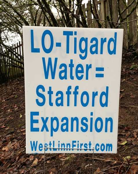 by: LORI HALL - Signs opposing the proposed Lake Oswego-Tigard water treatment plant expansion cropped up all over the city.