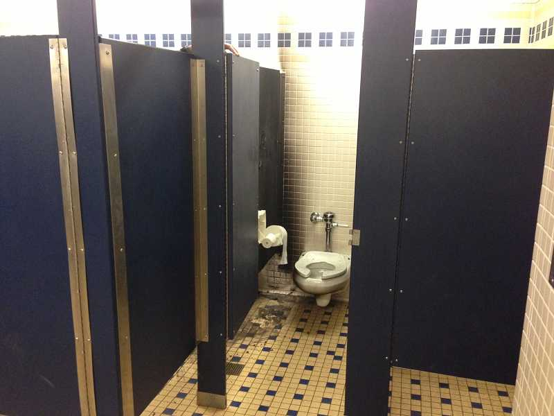 by: LAKE OSWEGO FIRE DEPARTMENT - A fire caused about $2,000 in damage to a Lake Oswego High School bathroom on Monday.