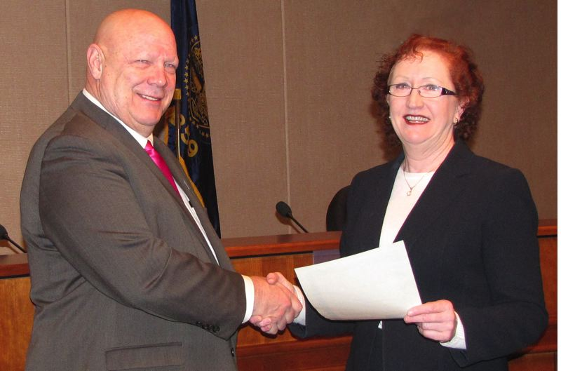 by: PHOTO COURTESY: CLACKAMAS COUNTY - New Clackamas County Chairman John Ludlow shakes hands with County Clerk Sherry Hall after he took office last week in a swearing-in ceremony administered by Circuit Court Judge Susie L. Norby.