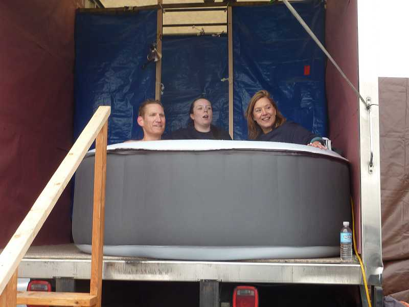 by: COURTESY OF TRESKE PRECISION MACHINING - A portable hot tub made the chilly day a little more comfortable for employees at Treske Precision Machining during last year's Oregon Law Enforcement Polar Plunge.