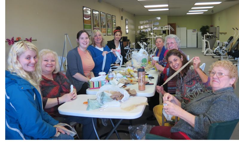 by: PHOTO BY: SHAWNA-RAE JOHNSON - The Gladstone Curves 'bag ladies' making a New Year's Day sleeping mat include Marcy Comella (from left), Joanne Comella, Aimee Johnson, Sharon Locey, Giselle Anguiano, Sara Wall, Jody Teetz, Maria Willard, Delphine Busch.