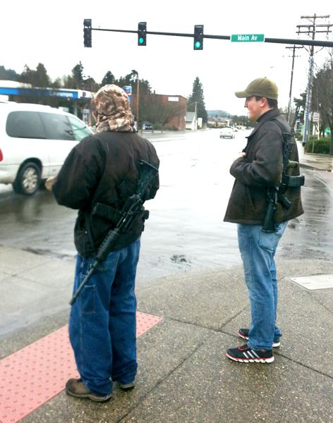 Jazzy Bagels employee Meghan Browne took this picture of Steven M. Boyce, right, and Warren R. Drouin, carrying assault rifles through downtown Gresham on Wednesday, Jan. 9.