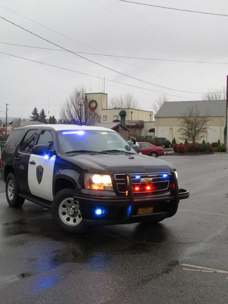 by: SPOTLIGHT PHOTO: KATIE WILSON - A Scappoose police vehicle blocks off access to City Hall near the Scappoose Public Library after police evacuated nearby buildings because of a bomb scare at City Hall Jan. 7.