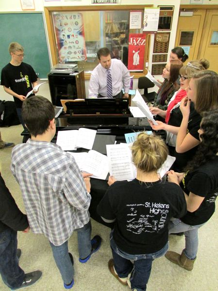 by: SPOTLIGHT PHOTO: KATIE WILSON - SoundFX, St. Helens High School's student a capella choir directed by teacher Kevin Zmolek (center), runs through songs at a new piano.