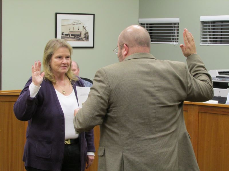 by: SPOTLIGHT PHOTO: KATIE WILSON - New Scappoose City Councilor Barbara Hayden is sworn in by Municipal Court Judge Nicholas Wood.