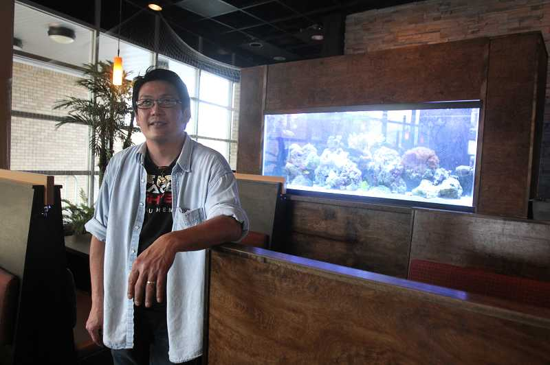 by: TIMES PHOTO: JONATHAN HOUSE - Ody Ratanaphupha is the owner of the new Planet Thai restaurant at The Round at Beaverton Central.