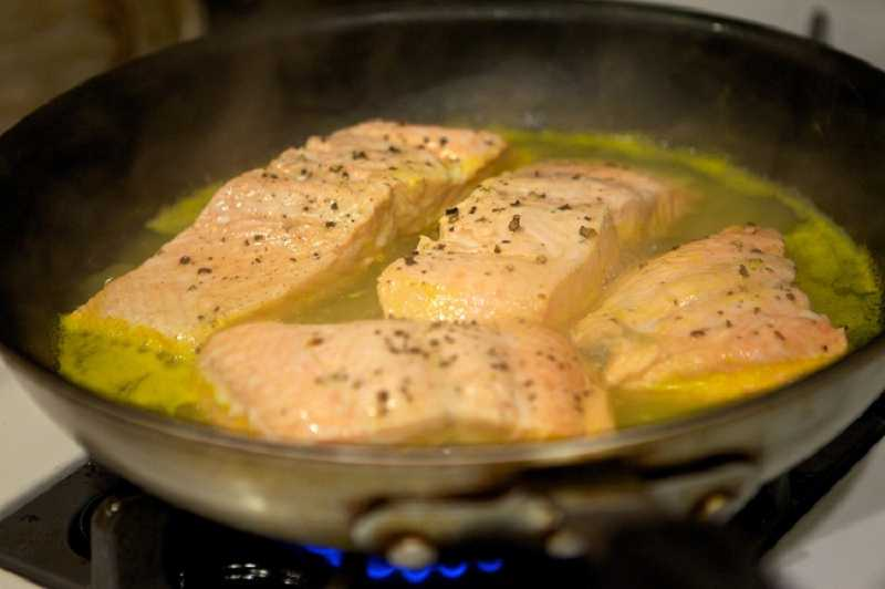 by: JAIME VALDEZ - Chef Perry Perkins of Tualatin-based hautemealz.com cooks poached salmon.