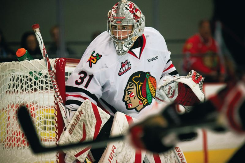 by: TRIBUNE PHOTO: CHRISTOPHER ONSTOTT - Mac Carruth makes one of his 23 saves in a 3-0 home win last week that vaulted into the Portland Winterhawks' record book as the winningest goaltender in team history. The victory, his 106th, pushed him one ahead of former Hawk Darrell May Sr.