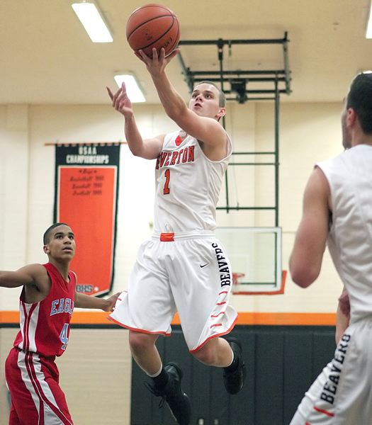 by: MILES VANCE - SCORING - Beaverton's Martin Tannler flies to the basket during his team's 59-39 non-league victory over the Eagles at Beaverton High School on Friday night.