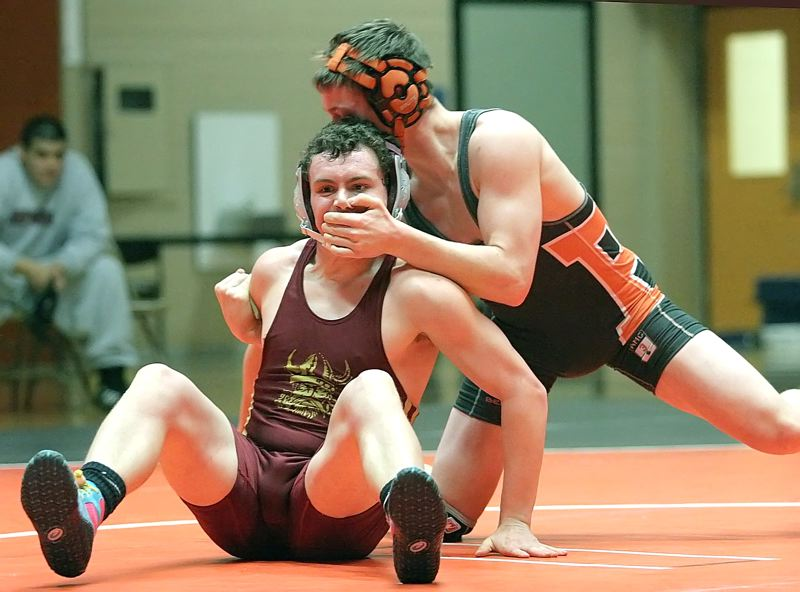 by: MILES VANCE - FACIAL - Beaverton junior Justin Wakem gets a grip on Forest Grove's Jake Kemper during their match at 145 pounds last week at Beaverton High School. Wakem pinned Kemper in the third round.