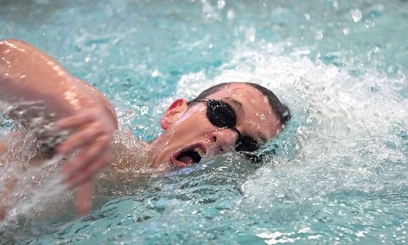 by: MILES VANCE - CHURNING - Sunset senior Cameron Stitt makes waves en route to winning the 500-yard freestyle against Westview last week.