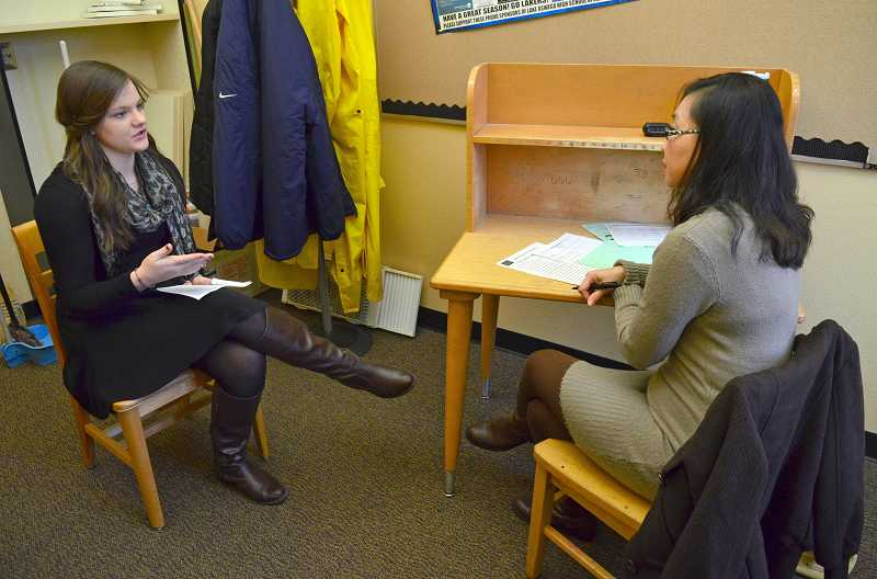 by: REVIEW PHOTO: VERN UYETAKE - Student Amber Swigler, left, is interviewed by parent volunteer Andrea Loo during a mock job interview experience.