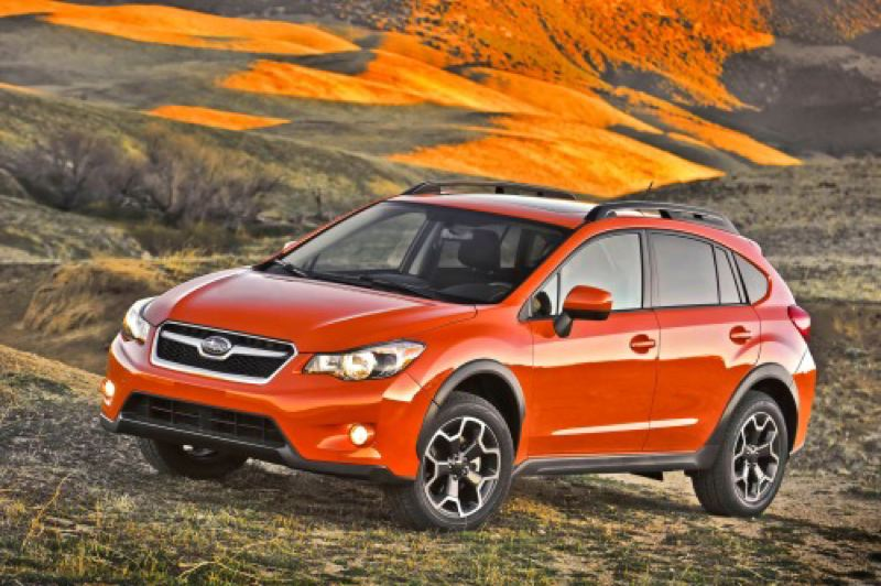 by: SUBARU OF AMERICA, INC. - Subaru's new 2013 XV Crosstrek is more off-road ready than the company's other small vehicles, thanks to a higher ride and protective cladding.