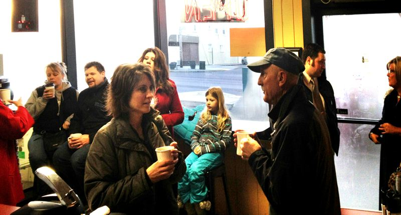 by: CONTRIBUTED PHOTO:  - A cash mob, mainly business owners, gathers for coffee and a scone or something similar after making a surprise visit to Sandy's newest business, Coffee Station. The early January networking opportunity helped everyone become familiar with and welcome a business to Sandy. CONTRIBUTED PHOTO