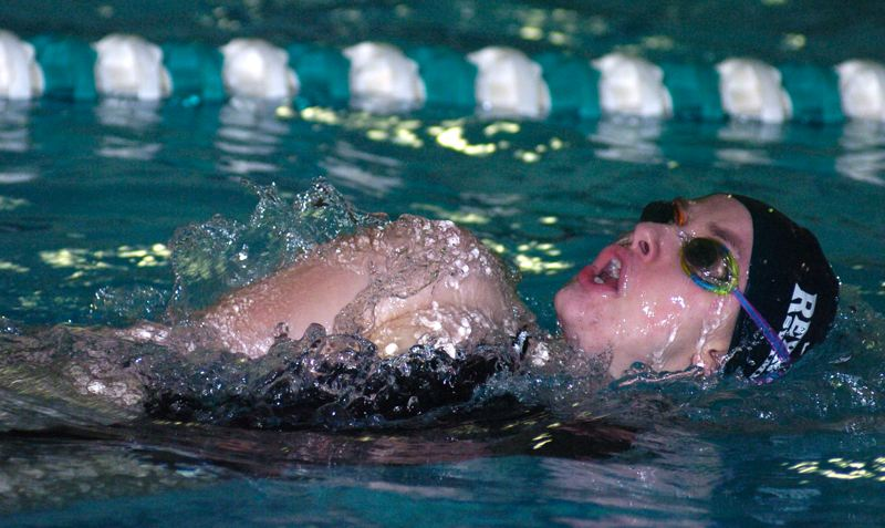 by: THE OUTLOOK: DAVID BALL - Reynolds' Abby Maricle takes a breath during her win in the backstroke Thursday, which brought the Raiders to within two points of St. Mary's late in the meet.