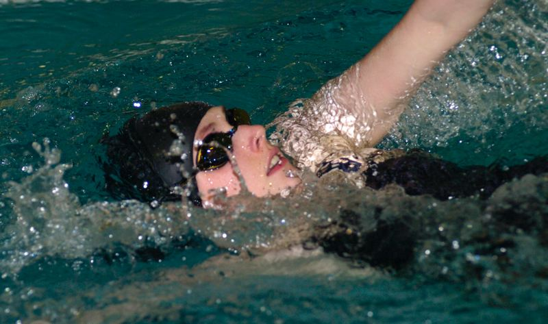 by: PAMPLIN MEDIA GROUP: DAVID BALL - Central Catholic's Catherine Nisbet powers through the water during her win in the 200 medley race Thursday against Centennial.