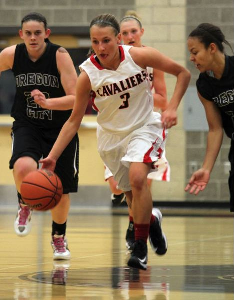 by: JONATHAN HOUSE - Clackamas junior Kaitlyn Reiner (3) takes the ball up the floor in Fridays game with top-ranked Oregon City. The 5-5 junior point guard scored a career- and game-high 24 points as the Cavaliers took the Pioneers down to the wire in a 58-57 losing effort.
