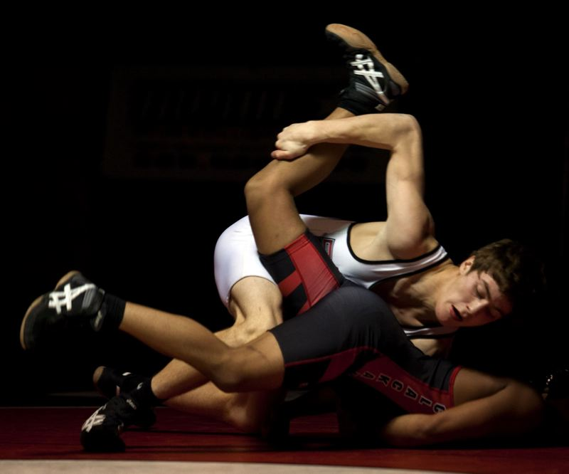 by: JONATHAN HOUSE - Oregon City junior Alex Canchola did everything but pin Clackamas senior Sam Riley en route to a technical fall at 145.