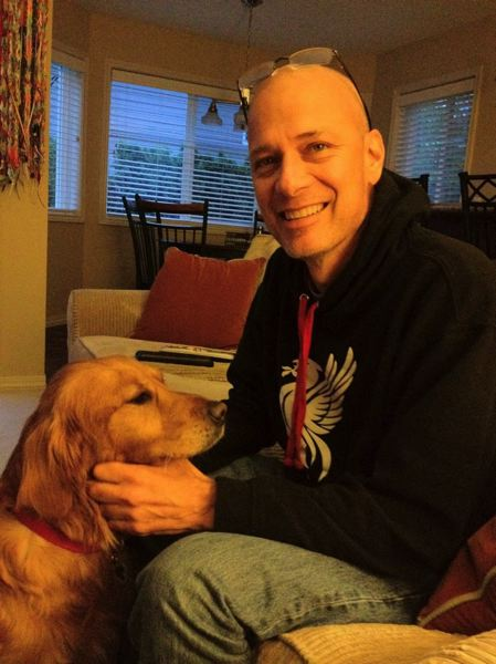 by: SUBMITTED PHOTO - Milwaukie resident Kurt Shull, who died of lung cancer in August at age 50, is pictured with his dog, Joy.