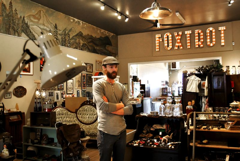 by: OUTLOOK PHOTO: JIM CLARK - Todd Paxson, owner of Foxtrot Vintage in downtown Gresham, uncovered the original fir flooring and a 1930s-era wall mural during renovation for his new antique mall. Signage for the shop was designed by his girlfriend.