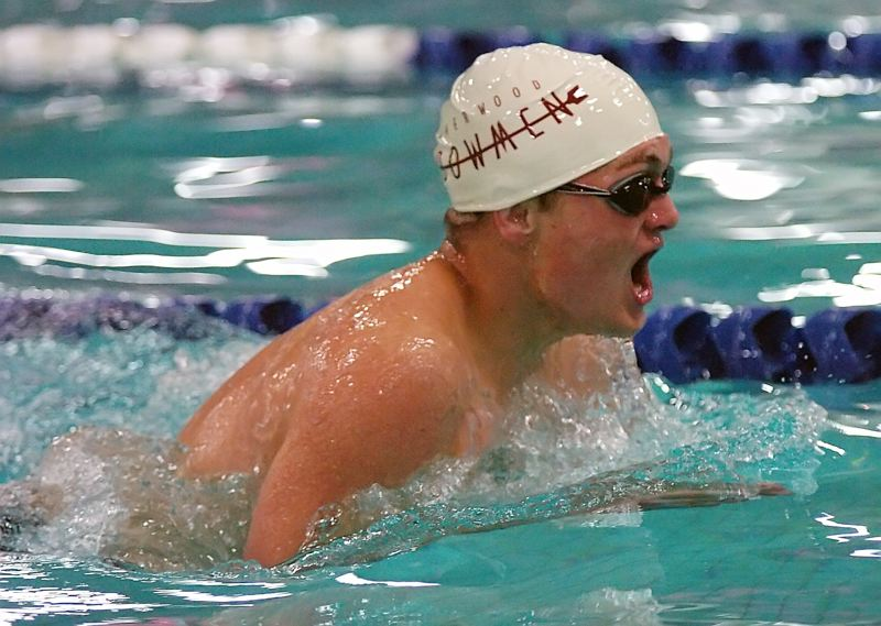 by: DAN BROOD - AX MAN -- Sherwood High School junior Ryan Ax is in first place in the 200-yard individual medley at last week's meet against Milwaukie.