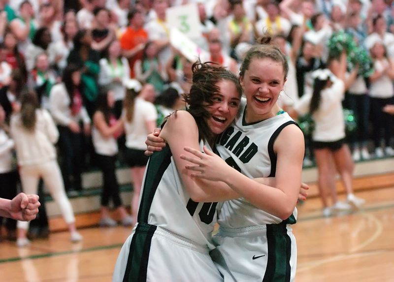 by: DAN BROOD - SUPER HAPPY -- Tigard seniors Meeka Mayhew (left) and Megan Risinger are all smiles following the overtime win over Tualatin.