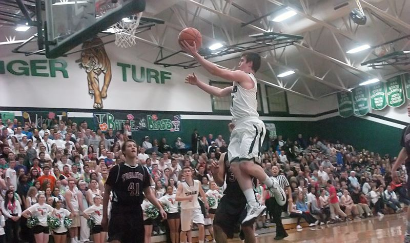 by: DAN BROOD - IN THE AIR -- Tigard senior guard Evan Garrison goes up to the basket during the Tigers' win over Tualatin.