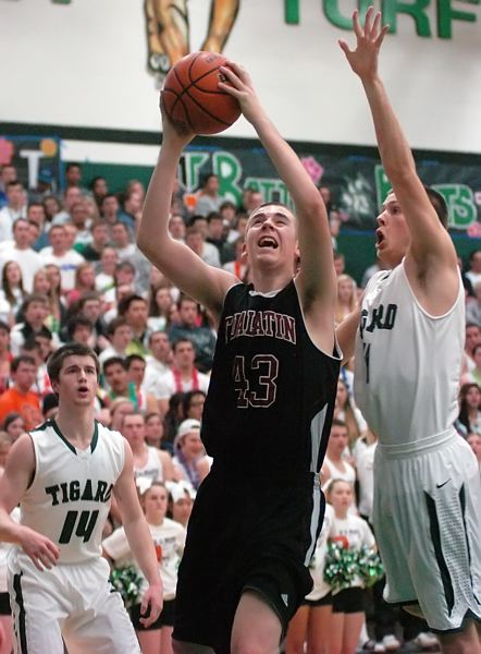 by: DAN BROOD - TO THE HOOP -- Tualatin High School sophomore post Jacob Bennett (43) looks to go up to the basket against Tigard senior Will Schaer.