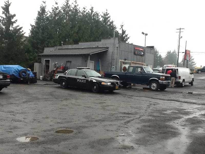 by: PHOTO COURTESY OF TIGARD POLICE. - Police serve a search warrant at an alleged Tigard chop shop, on Jan. 10.