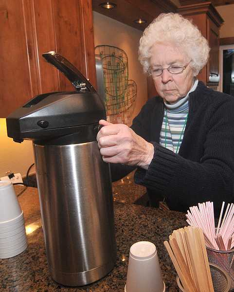 by: VERN UYETAKE - Volunteer Joan Meyers has volunteered to serve students at Coffee Cart for 17 years.