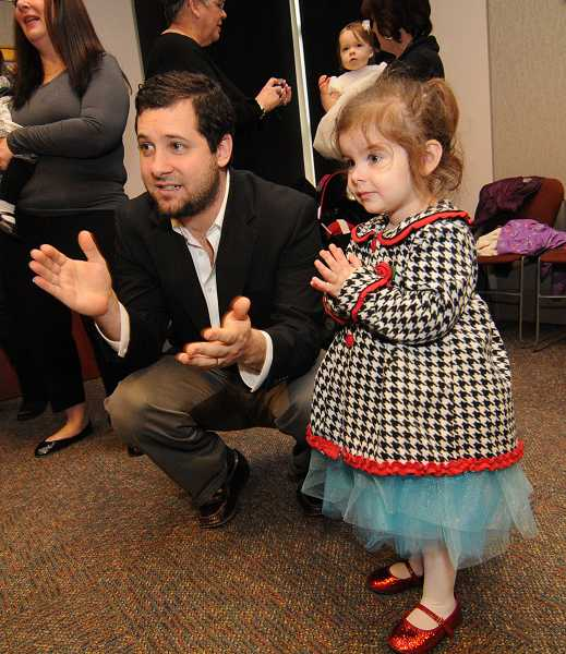 by: VERN UYETAKE - Matt Ferrud and his daughter, Stella, enjoy the music at the West Linn Public Library.