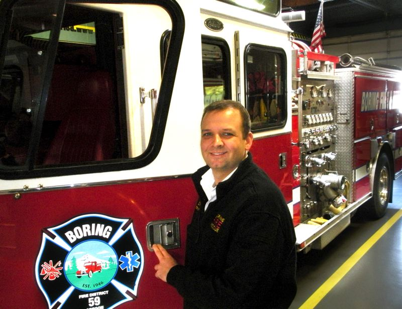 by: POST PHOTO: JIM HART - POST PHOTO: JIM HART Boring Interim Fire Chief Brian Stewart stands near one of the engines housed in the Boring main station. The fire board has not yet decided if it wants to offer the permanent fire chief position to Stewart or begin a national search.