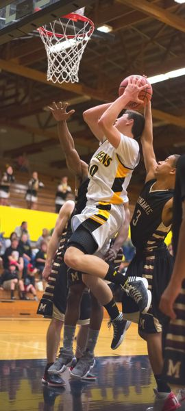 by: JEREMY DUECK - St. Helens' Tanner Long moves to the bucket during las week's game with visiting Milwaukie.