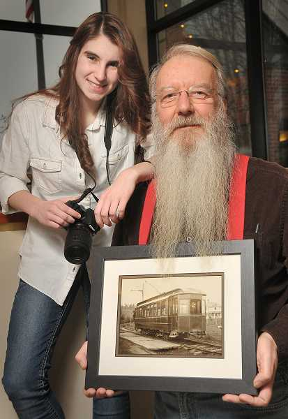 by:  VERN UYETAKE  - Photographer Kendra Frankle and photo restorationist John Klatt create past and present images of West Linn with the centennial photo project.