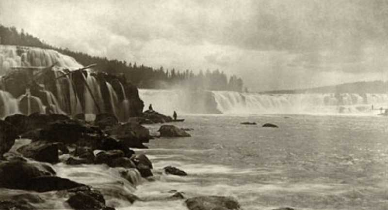 by: OLD OREGON PHOTOS - 'Two Cultures at Willamette Falls' by photographer Isaac G. Davidson, circa 1880. Note the Native American fisherman on the far right.