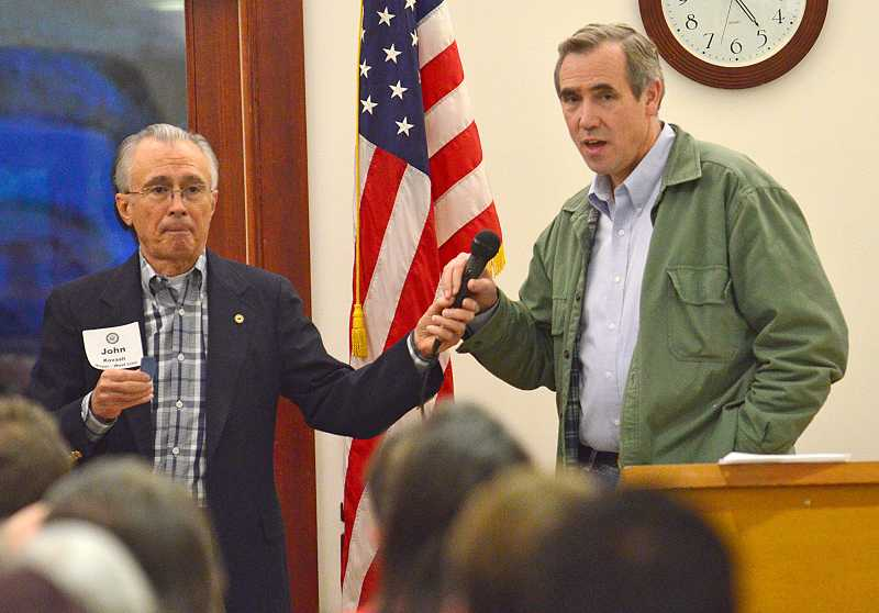 by: VERN UYETAKE - West Linn Mayor John Kovash helped field questions directed to Sen. Jeff Merkley during Merkley's town hall meeting Jan. 9.