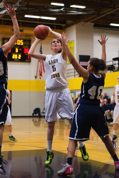 by: JEREMY DUECK - St. Helens' Lucy Kyle-Milward fires up a shot during last week's game with Milwaukie.