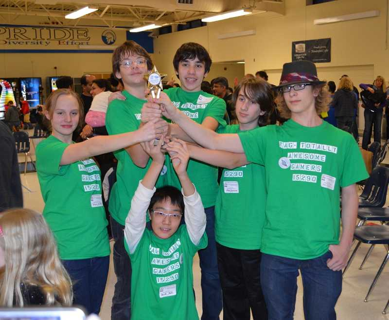 by: SUBMITTED PHOTO - Pictured are, from left, Tonya Bradley, Zander Work, David Park, Jason O'Brien, Blake Shanaberger and Soul Trick of the Totally Awesome Gamers. The team won a Core Values trophy at a recent competition.