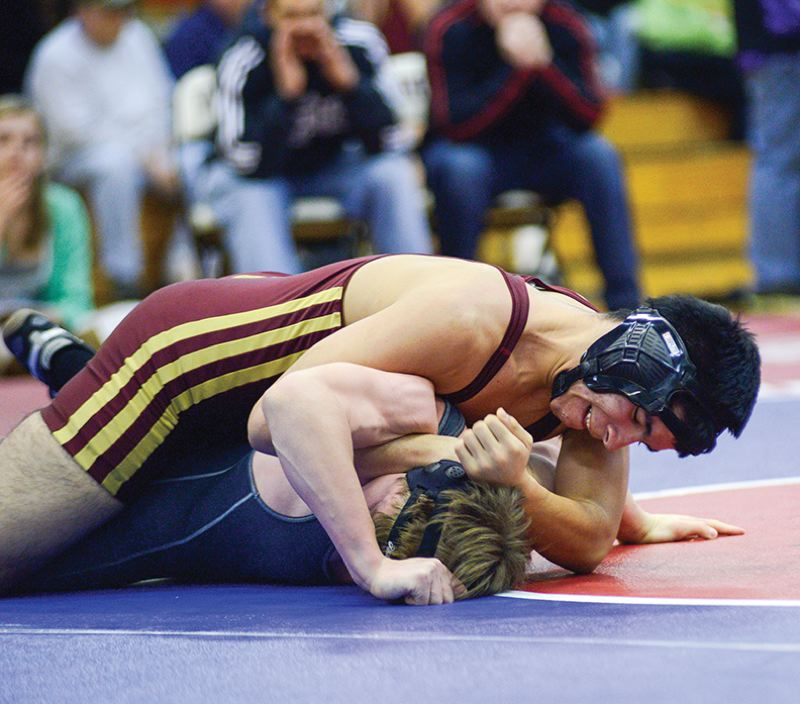 by: CHASE ALLGOOD - Forest Grove's Nathaniel Calderon wrestles in the 160-pound consolation bracket en route to a fourth-place finish at the Bob Beisell Invitational.