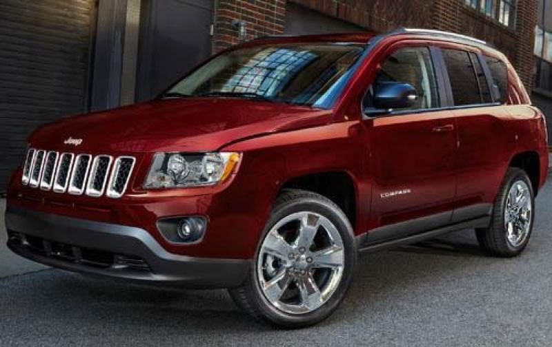 by: CHRYSLER LLC - The 2013 Jeep Compass compact crossover looks like a smaller version of the company's successful full-size Grand Cherokee.