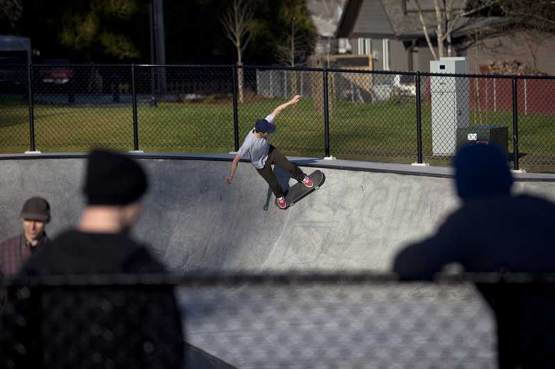 by: TIMES PHOTO: JONATHAN HOUSE  - Skateboarders enjoy the new skate park during the reopening day at Evelyn M. Schiffler Memorial Park.