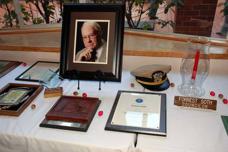 by: TIMES PHOTO: CHRISTINA LENT - Tables in St. Matthew Lutheran Church's Courtyard Fellowship Hall were graced with mementos marking milestones in Forrest Soth's life during a memorial service Saturday.