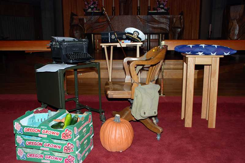 by: TIMES PHOTO: CHRISTINA LENT  - Forrest Soth planned his own memorial, but his family assembled the setting in front of the church pulpit: His vintage wooden chair, a metal typing table topped with a black Underwood manual typewriter, complete with a memo related to the city's urban renewal program. A fishing pole, an American flag and mementos of his military and private-sector careers further enhanced the set, which was surrounded by crates of Oregon-grown vegetables.