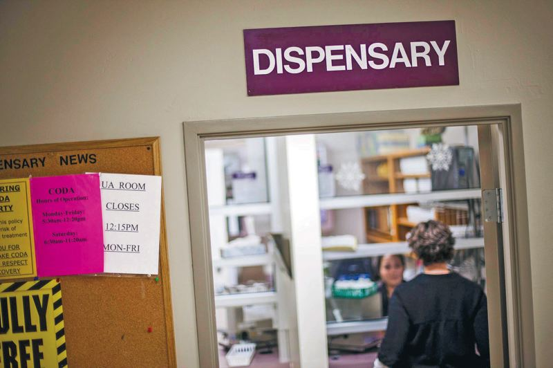 by: TRIBUNE PHOTO: CHRISTOPHER ONSTOTT - Patients pick up their doses from the methadone dispensary at CODA, a nonprofit that specializes in addiction recovery.
