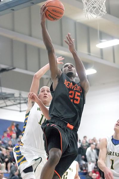 by: MILES VANCE - SKY HIGH - Beaverton senior Hakeem Bradley soars past Aloha's Edgar Guerra to score in his team's 47-39 win at Aloha on Friday.