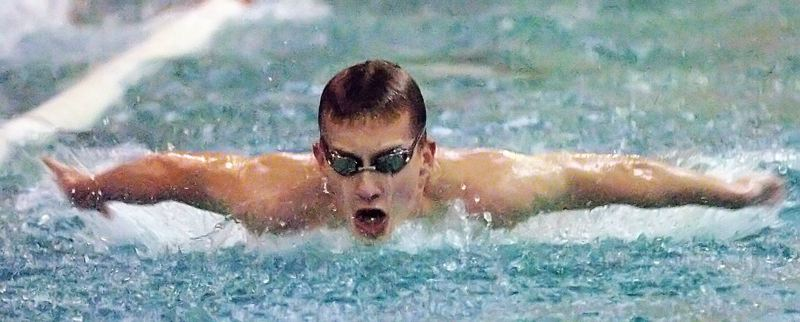 by: DAN BROOD - WINNER -- Tualatin senior John Cameron is on his way to victory in the 100-yard butterfly.