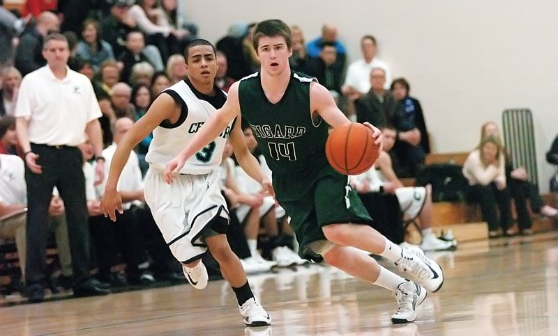 by: DAN BROOD - TIGER ON THE MOVE -- Tigard senior guard Evan Garrison heads up court ahead of Century's Jamel Liggins in Friday's game.